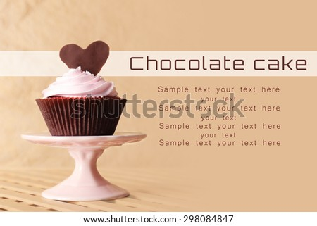 Delicious Valentine Day cupcake on table - stock photo