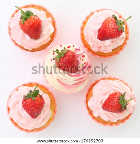 Delicious vanilla cupcake with strawberry frosting and fresh strawberry - stock photo