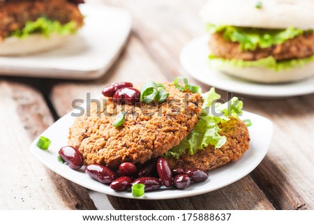 Delicious vegetable bean burgers with herbs and garnish - stock photo