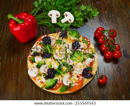 Delicious vegetarian pizza with mushrooms, corns and broccoli - stock photo