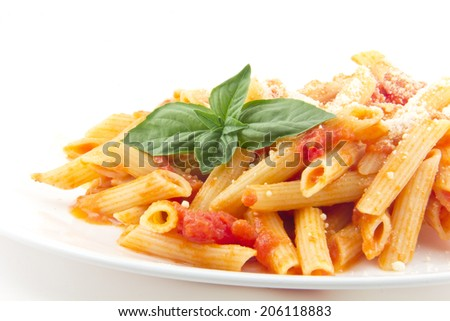 Delicious vodka penne garnished with basil leaves and isolated on white  - stock photo