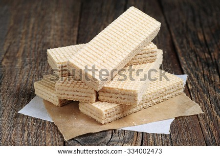 Delicious wafers on a dark wooden table - stock photo