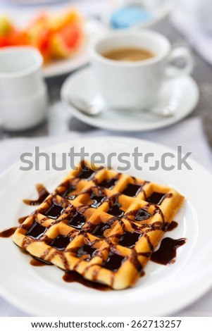 Delicious waffles with coffee served for breakfast at resort restaurant - stock photo