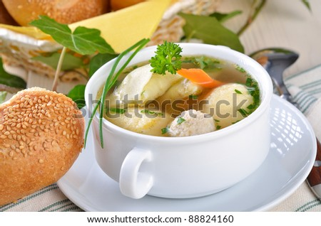 Delicious wedding soup with semolina dumplings, bone marrow dumplings and stuffed ravioli - stock photo