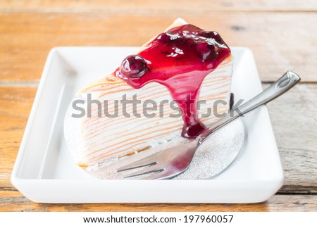 Delicious whipped cream crepe cake with blueberry sauce, stock photo - stock photo