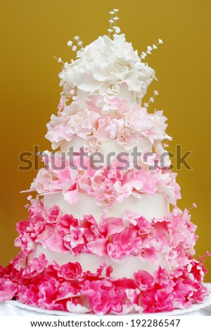 Delicious white and pink wedding cake  - stock photo