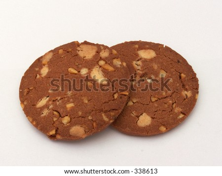 Delicious white chocolate chips cookies with hazelnuts - stock photo