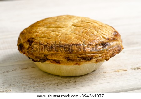 delicious Whole Chicken Puff Pastry Pie on a White Background - stock photo