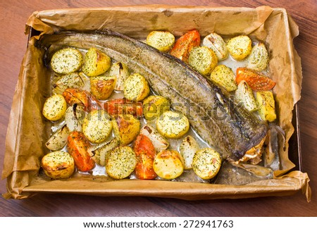 Delicious whole cod with vegetables - stock photo