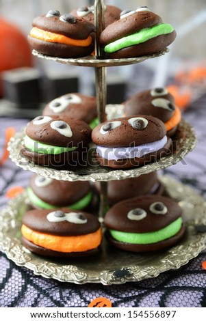 delicious whoopie pies with eyes for halloween - stock photo