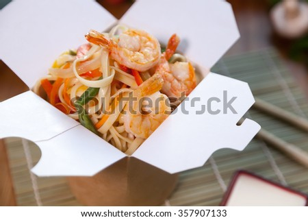Delicious wok box with shrimps - stock photo