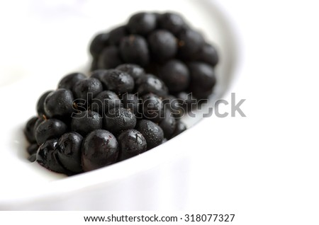 Delicious yogurt and fresh berries for breakfast - stock photo