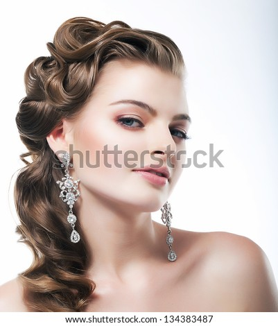 Delight. Elegant Posh Woman Bride with Diamond Earrings. Platinum Jewelry - stock photo