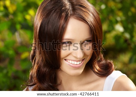Delightful beauty with curly hair against magnificent vegetation - stock photo