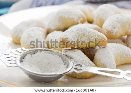 Delightful fresh baked Kourabiedes - a Greek butter cookie with icing sugar. - stock photo