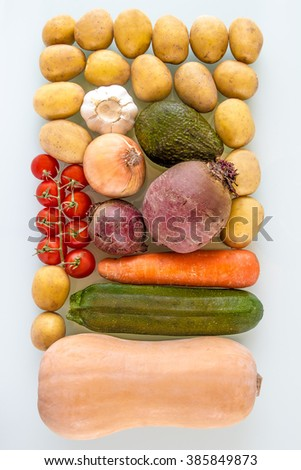 Delightful Vegetable Soup Ingredients ready for cooking. zenith angle. Butternut squash, zucchini, carrots, onion, beetroot, garlic, avocado and potatoes isolated. - stock photo