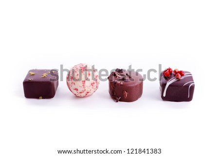 delisious sweet praline collection mixed isolated on white closeup - stock photo