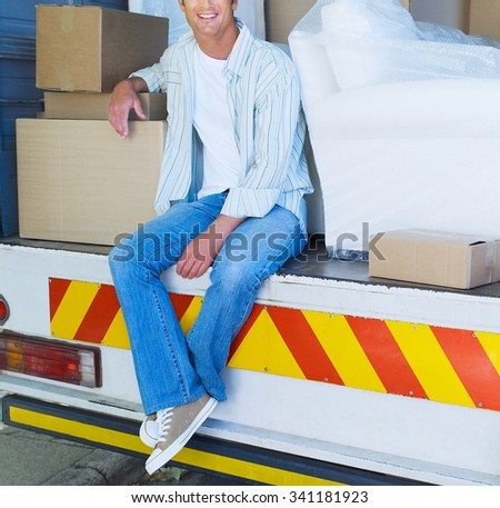 Delivery driver outside the warehouse - stock photo