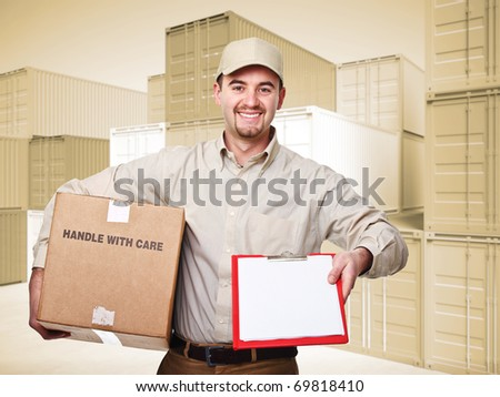 delivery man at work and 3d container sepia background - stock photo