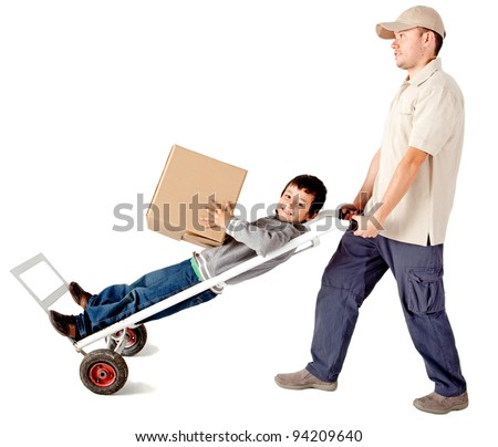 Delivery man carrying a boy in a trolley - isolated over a white background - stock photo