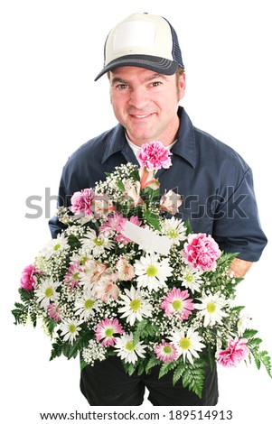 Delivery man delivers a bouquet of flowers for Mother's Day, birthday, or other special occasion.  Isolated on white.   - stock photo