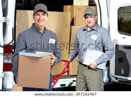 Delivery man near shipping truck. - stock photo