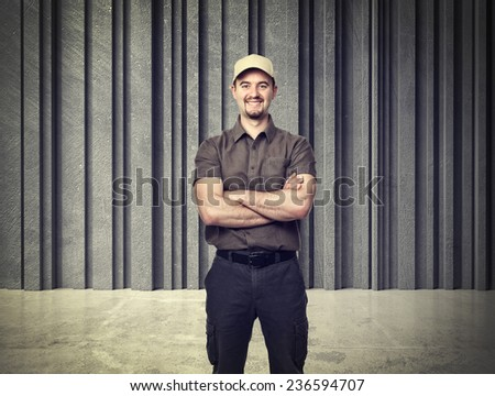 delivery man portrait and concrete background - stock photo