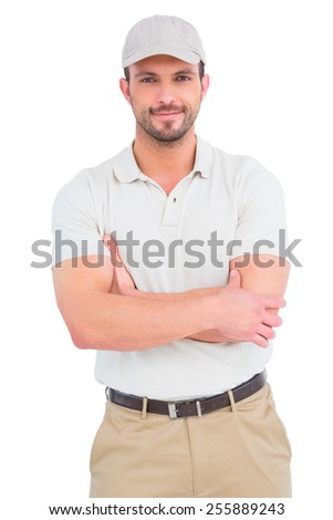 Delivery man standing arms crossed on white background - stock photo