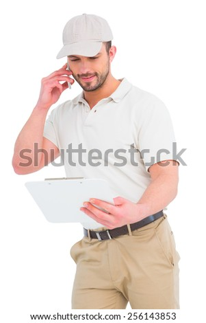 Delivery man talking on mobile phone over white background - stock photo