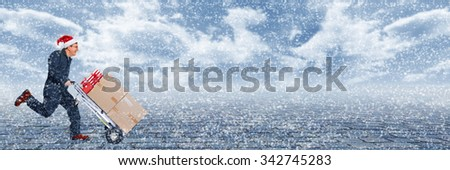 Delivery man with boxes. Express Christmas shipping. - stock photo