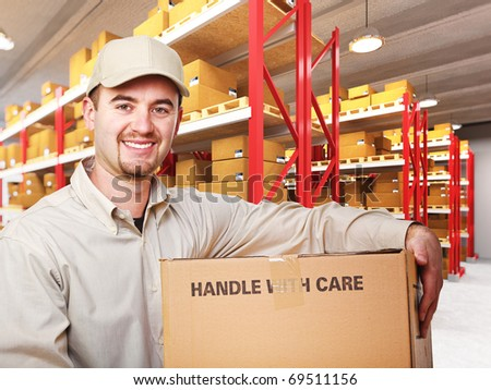 delivery man with parcel in warehouse 3d background - stock photo