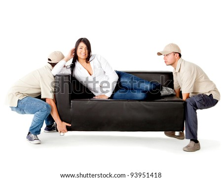 Delivery men carrying a woman lying on the sofa - isolated over a white background - stock photo