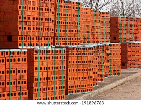 Delivery of red bricks for the construction of a new home by Builders. - stock photo