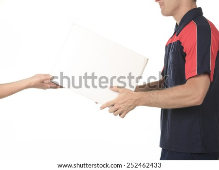 Delivery person delivering packages holding clipboard and package - stock photo
