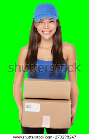 Delivery person holding packages wearing blue cap. Woman courier smiling happy isolated on green screen chroma key background.. Beautiful young mixed race Caucasian / Chinese Asian female professional - stock photo