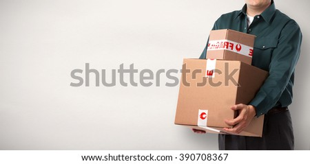 Delivery postman with a box. - stock photo