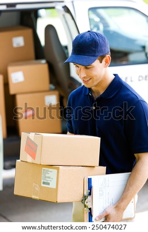 Delivery: Taking Boxes From Van to Home - stock photo