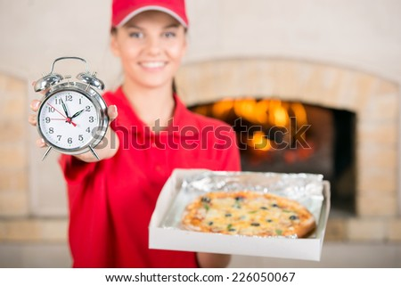 Delivery woman with delicious pizza in pizza box. - stock photo
