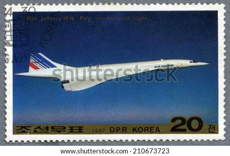 Democratic People's Republic of Korea - CIRCA 1987: A stamp printed in Democratic People's Republic of Korea -  Tu-144 and General Designer Tupolev, circa 1987  - stock photo