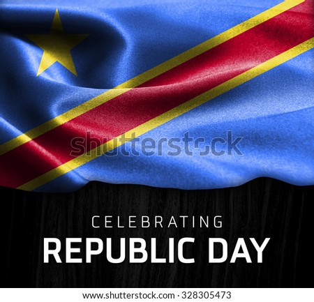 Democratic Republic of the Congo flag and Celebrating Republic Day Typography on wood background - stock photo