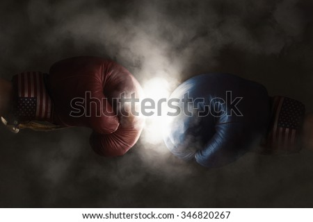 Democrats and Republicans in the campaign symbolized with Boxing Gloves - stock photo