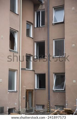Demolished House with empty windows - stock photo