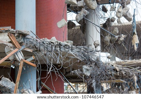 Demolition of a building with concrete floors and pillars - stock photo