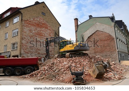Demolition of old city house - stock photo