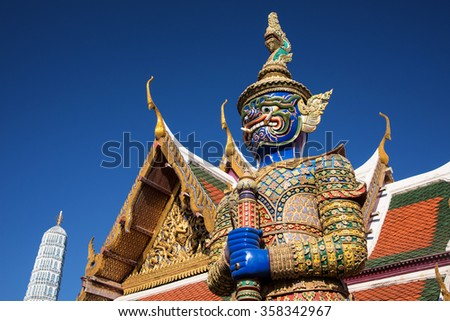 Demon Guardian against blue sky at Wat Phra Kaew, Temple of Emerald Buddha, Bangkok, Thailand - stock photo