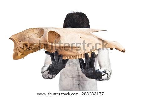 Demon holding horse skull - stock photo