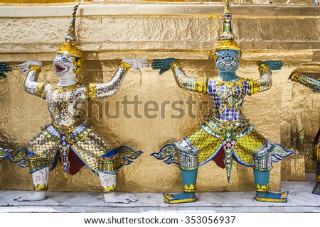 Demons mythical creatures guarding The Golden Stupa at Grand Palace in Bangkok. Thailand.  - stock photo