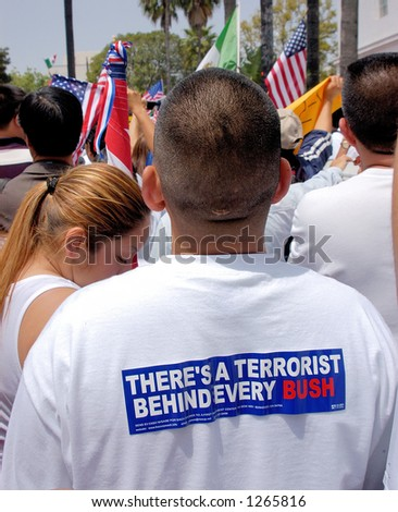 Demonstrators at Los Angeles illegal emigrant rally, with bumper sticker on t-shirt, May 1st 2006 - stock photo