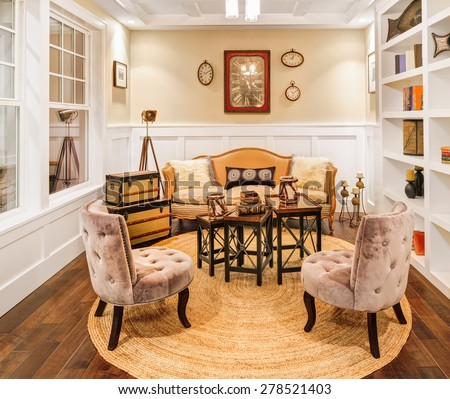 Den and Reading Room in Luxury Home with Hardwood Floors and Wainscoting  - stock photo