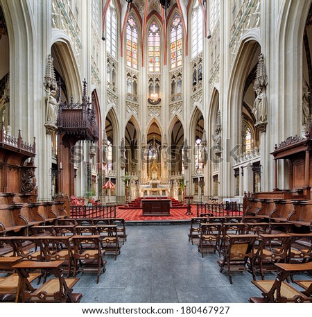 DEN BOSCH, NETHERLANDS - FEBRUARY 25: Symmetrical composition of the interior in the gothic medieval cathedral of Saint John, one of top attractions of Den Bosch, Netherlands, February 25, 2014. - stock photo